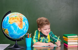 Funny little boy in classroom.  Royalty Free Stock Photo