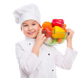 Funny little boy-cook holding bowl with vegetables in hands Royalty Free Stock Image