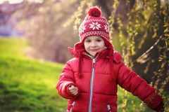 Funny little boy, enjoying sunny spring day at the park Royalty Free Stock Image
