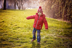 Funny little boy, enjoying sunny spring day at the park Stock Images