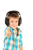 Funny little boy with headphones Stock Images