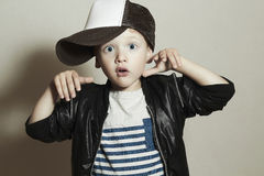Funny little boy.Hip-Hop Style. fashion children.Surprised emotion. Funny little boy.Hip-Hop Style. fashion children.handsome.Pose Boy in Tracker Hat. Young Stock Photography
