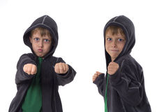 Funny little boy with hood. Two studio shots, isolated on white background Royalty Free Stock Photography