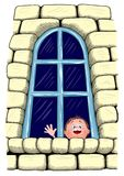 Funny little boy looks out the window and waves his hand royalty free stock image