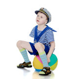 Funny little boy in marine inflatable ball suit royalty free stock photo