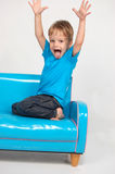Funny little boy misbehaving. Isolated Royalty Free Stock Image