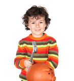 Funny little boy with a moneybox. Funny little boy with a hammer for break the moneybox Royalty Free Stock Photography