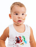 Funny little boy with painted face and shirt Stock Photo