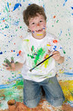 Funny little boy painted his hand Royalty Free Stock Images