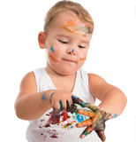 Funny little boy painting his hands Royalty Free Stock Photo