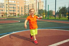 Little boy on playground. Funny little boy on playground. playing child on sports ground Stock Photography