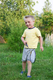 Funny little boy playing in badminton Stock Photos