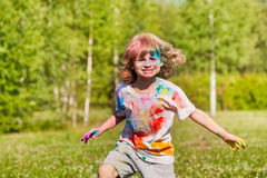 Funny little boy playing with colored powder Stock Image