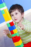 Funny little boy playing with plastic Royalty Free Stock Images
