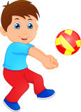 Funny little boy playing volley ball Royalty Free Stock Images
