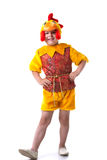 Funny little boy posing in cockerel suit Royalty Free Stock Photo