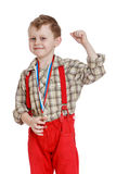 Funny little boy in red shorts with straps. Isolated on white background Stock Photo