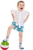 Funny little boy in shorts playing football Royalty Free Stock Photography
