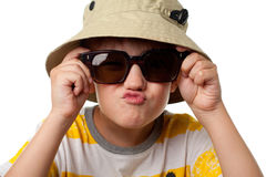 The funny little boy in sun glasses close up isolated Royalty Free Stock Photography