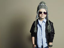 Funny little boy in sunglasses.stylish child in hat Stock Photo