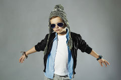 Funny little boy in sunglasses Stock Images