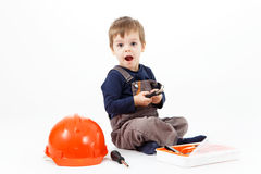 Funny little boy with tools kit on white background Stock Photo