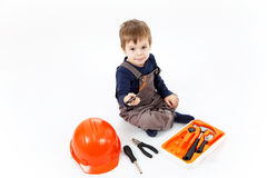 Funny little boy with tools kit on white background Royalty Free Stock Photo