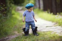 Funny little boy in uniform stock image