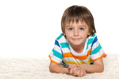 Funny little boy on the white carpet Royalty Free Stock Photo