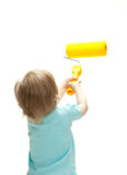 Funny little child with a big paint roller Stock Image