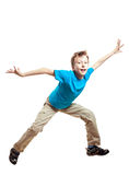 Funny little child in blue t-shirt jumping and dancing Royalty Free Stock Image