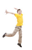 Funny little child in colorful t-shirt jumping and laughing Stock Images
