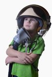 Funny little child in fighter pilot helmet isolated on white background Stock Photo