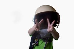 Funny little child in fighter pilot helmet isolated on white background Royalty Free Stock Photo