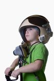 Funny little child in fighter pilot helmet isolated on white background Royalty Free Stock Images