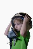 Funny little child in fighter pilot helmet isolated on white background Royalty Free Stock Photography