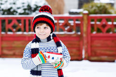 Funny little child holding big cup with snowflakes and hot choco Stock Image