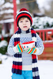 Funny little child holding big cup with snowflakes and hot choco Royalty Free Stock Photos