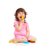 Funny little child playing with colorful toys, Royalty Free Stock Photos
