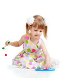 Funny little child playing with colorful toys Stock Photos