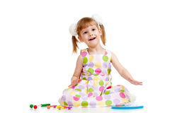 Funny little child playing with colorful toys Royalty Free Stock Image
