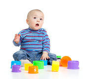 Funny little child playing with cup toy over white Stock Image