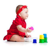 Funny little child playing with cup toys Stock Photography