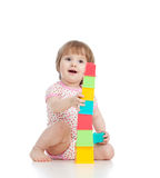 Funny little child playing with cup toys Stock Images
