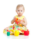 Funny little child is playing with toys Stock Image