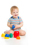 Funny little child playing with toys Stock Photos