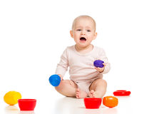 Funny little child is playing with toys Stock Images