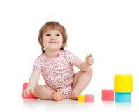 Funny little child is playing with toys Royalty Free Stock Images