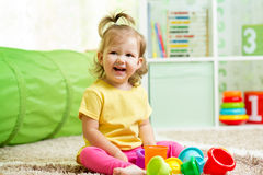 Funny little child playing with toys Stock Photo