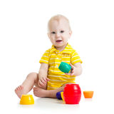 Funny little child is playing with toys isolated over white Stock Images